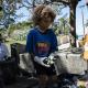 A young volunteer sorts trash in Saint-Pierre, Reunion Island, France, Sept. 18, 2021.Bastien Doudaine/Bastien Doudaine / Hans Lucas